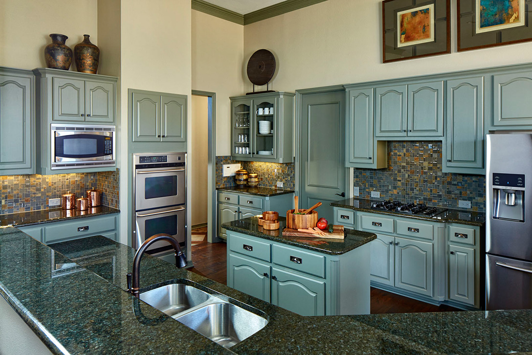 Transitional rustic bachelor pad in double oak tx for Texas kitchen designs