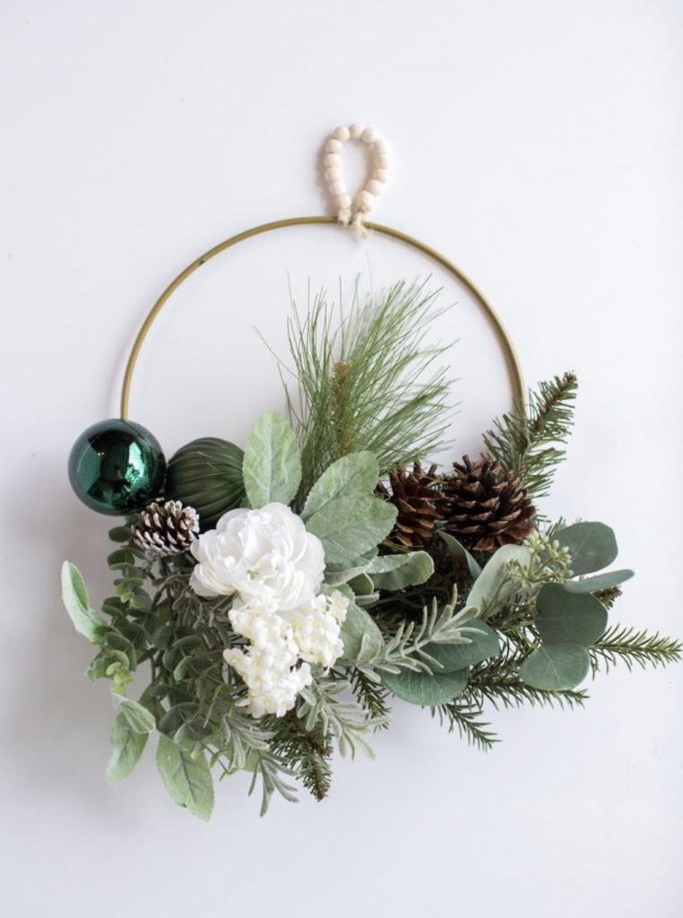 Nature-Inspired Boho Christmas Wreath in neutral colors of green, chocolate brown, creamy white, and gold.