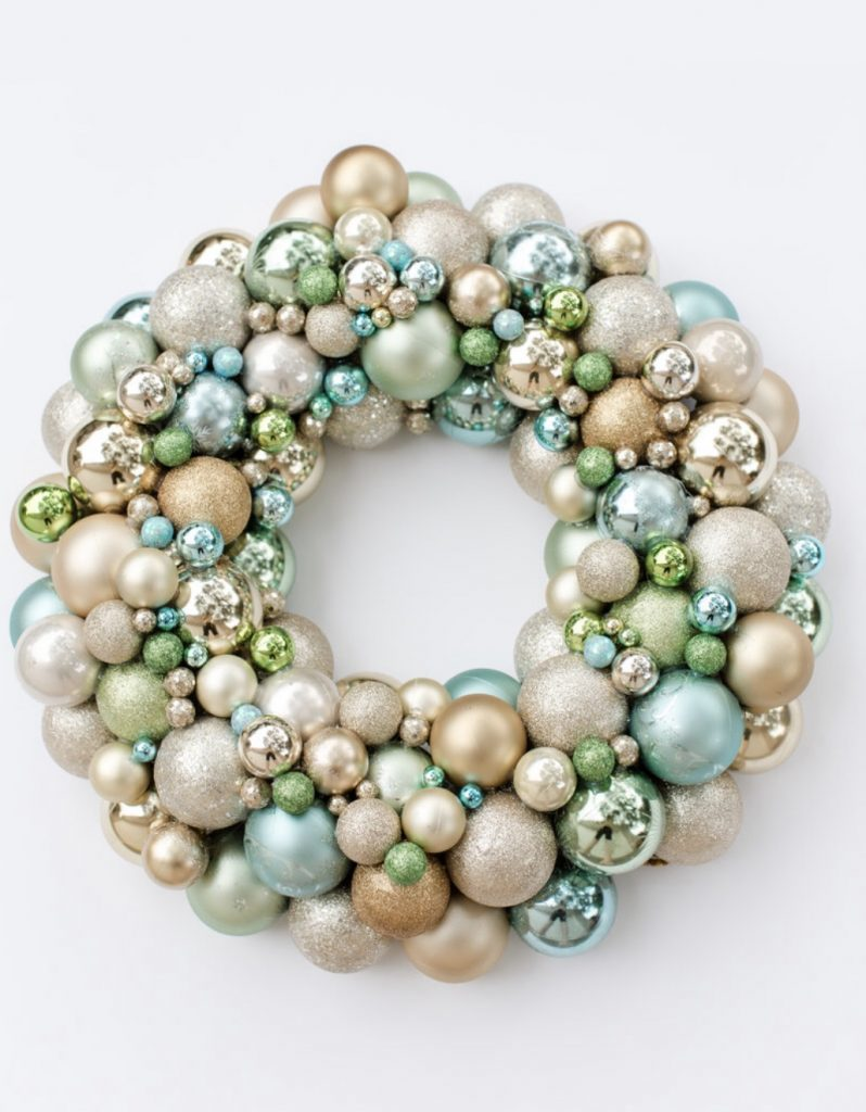 Kristy Mastrandonas Interior Design & Styling - Flower Mound TX - Elegant Christmas Ball Ornament in shades of turquoise, creamy ivory, gold, and green.